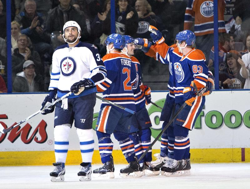Oilers pound Jets 6-2