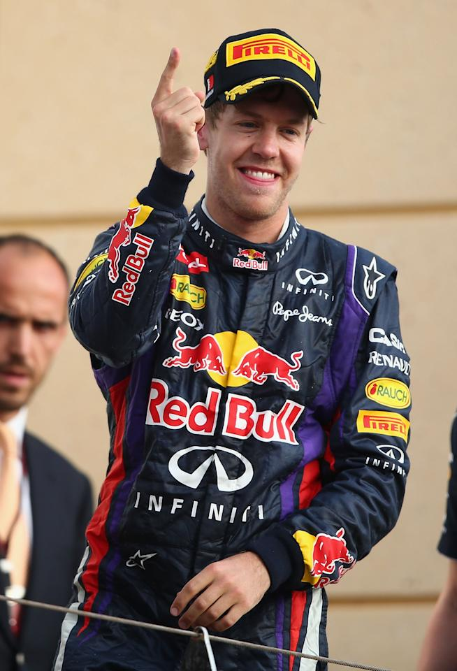 SAKHIR, BAHRAIN - APRIL 21:  Sebastian Vettel of Germany and Infiniti Red Bull Racing celebrates on the podium after winning the Bahrain Formula One Grand Prix at the Bahrain International Circuit on April 21, 2013 in Sakhir, Bahrain.  (Photo by Clive Mason/Getty Images)