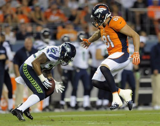 Manning's home debut so-so in loss to Seattle