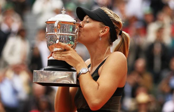 PARIS, FRANCE - JUNE 09:  Maria Sharapova of Russia kisses the Coupe Suzanne Lenglen after the women's singles final against Sara Errani of Italy during day 14 of the French Open at Roland Garros on June 9, 2012 in Paris, France.  (Photo by Matthew Stockman/Getty Images)