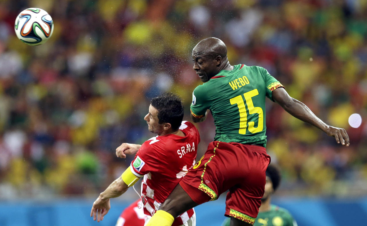 Cameroon's Pierre Webo, right, and Croatia's Darijo Srna battle for the ball during the group A World Cup soccer match between Cameroon and Croatia at the Arena da Amazonia in Manaus, Brazil, Wednesday, June 18, 2014. (AP Photo/Themba Hadebe)