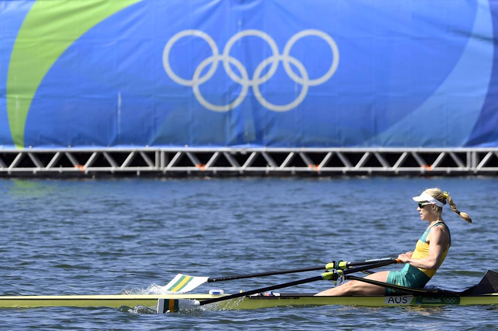 Australia's Kimberley Brennan rows to win the Women's Single Sculls final rowing competition at the Lagoa stadium during the Rio 2016 Olympic Games in Rio de Janeiro on August 13, 2016. (AFP Photo/Damien MEYER)
