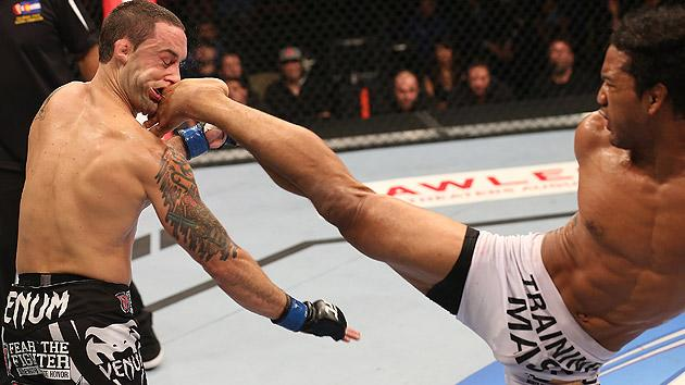 Benson Henderson kicks Frankie Edgar in the face during their UFC 150 fight.