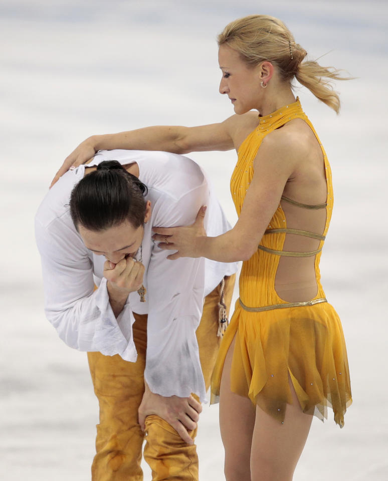 Fedor Klimov and Ksenia Stolbova of Russia react after they completed their routine in the pairs free skate figure skating competition at the Iceberg Skating Palace during the 2014 Winter Olympics, Wednesday, Feb. 12, 2014, in Sochi, Russia. (AP Photo/Ivan Sekretarev)
