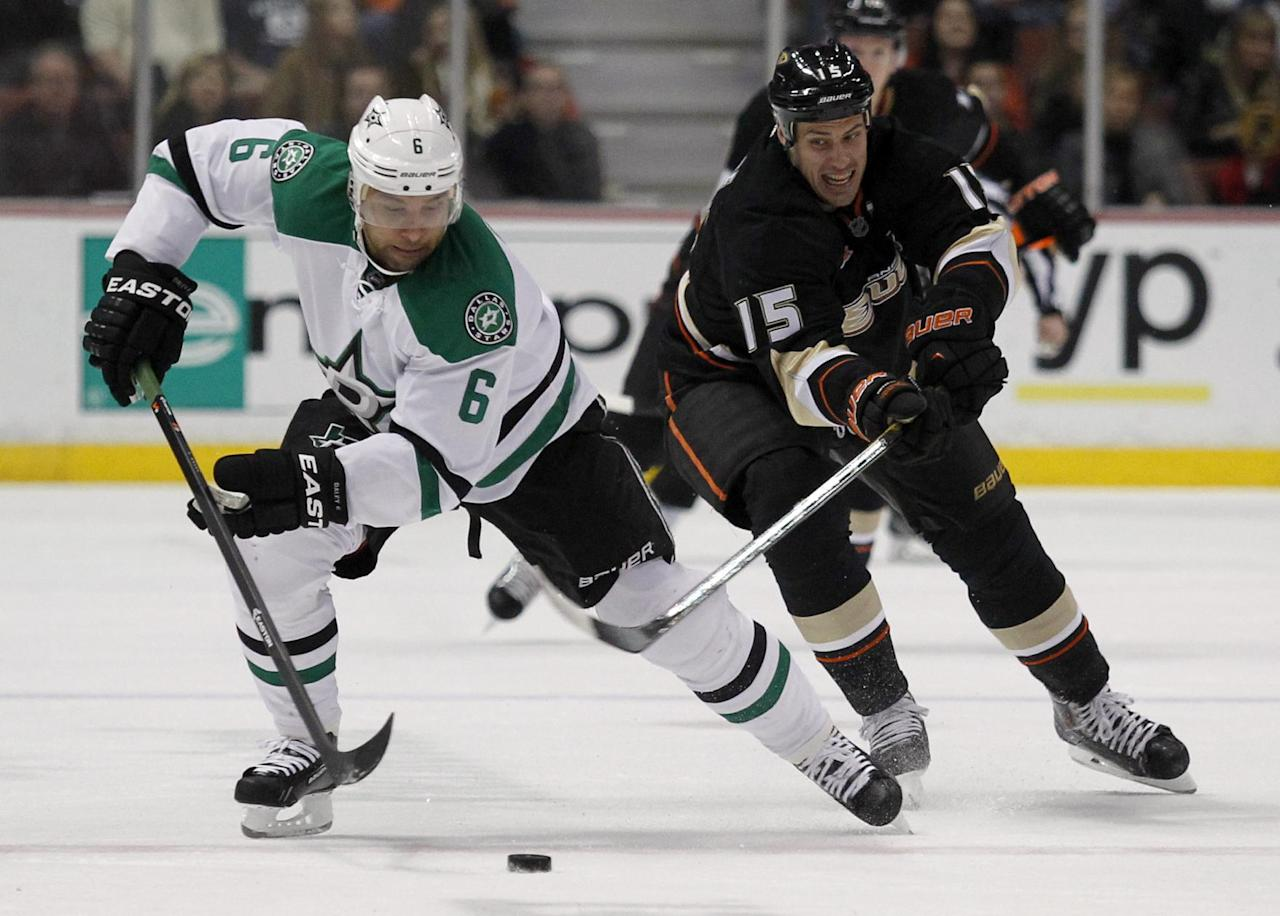 Anaheim Ducks center Ryan Getzlaf (15) hooks with his stick to stop Dallas Stars defenseman Trevor Daley (6) in the first period of an NHL hockey game Saturday, Feb. 1, 2014, in Anaheim, Calif. (AP Photo/Alex Gallardo)