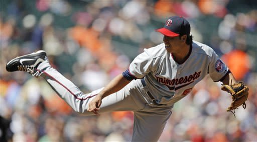 Hammel leads Orioles to 3-1 win over Twins