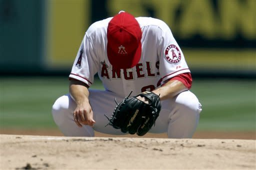 Greinke outpitched by Hellickson in Angels' debut