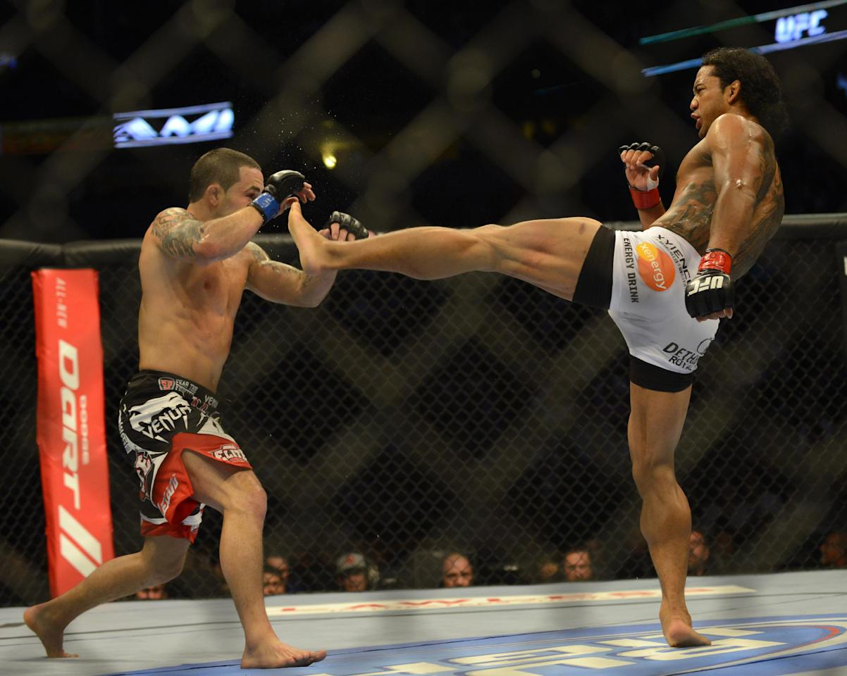 Benson Henderson from Arizona, right, kicks Frankie Edgar from New Jersey in the face in their middleweight title bout during UFC 150 in Denver, Saturday, Aug. 11, 2012. Henderson won the bout.(AP Photo/Jack Dempsey)