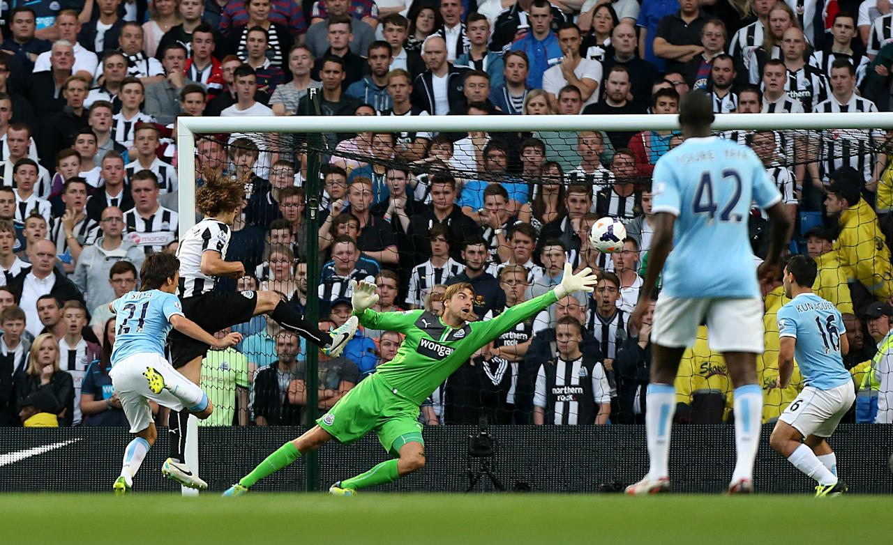 Manchester City's David Silva scores the opening goal of the game