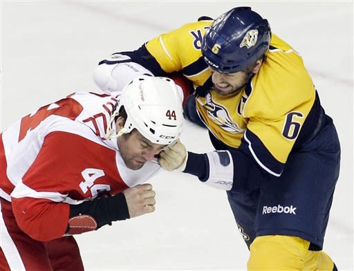 Detroit Red Wings right wing Todd Bertuzzi (44) fights with Nashville Predators defenseman Shea Weber (6) in the first period of Game 2 of an NHL hockey Stanley Cup first-round playoff series, Friday, April 13, 2012, in Nashville, Tenn. (AP Photo/Mark Humphrey)