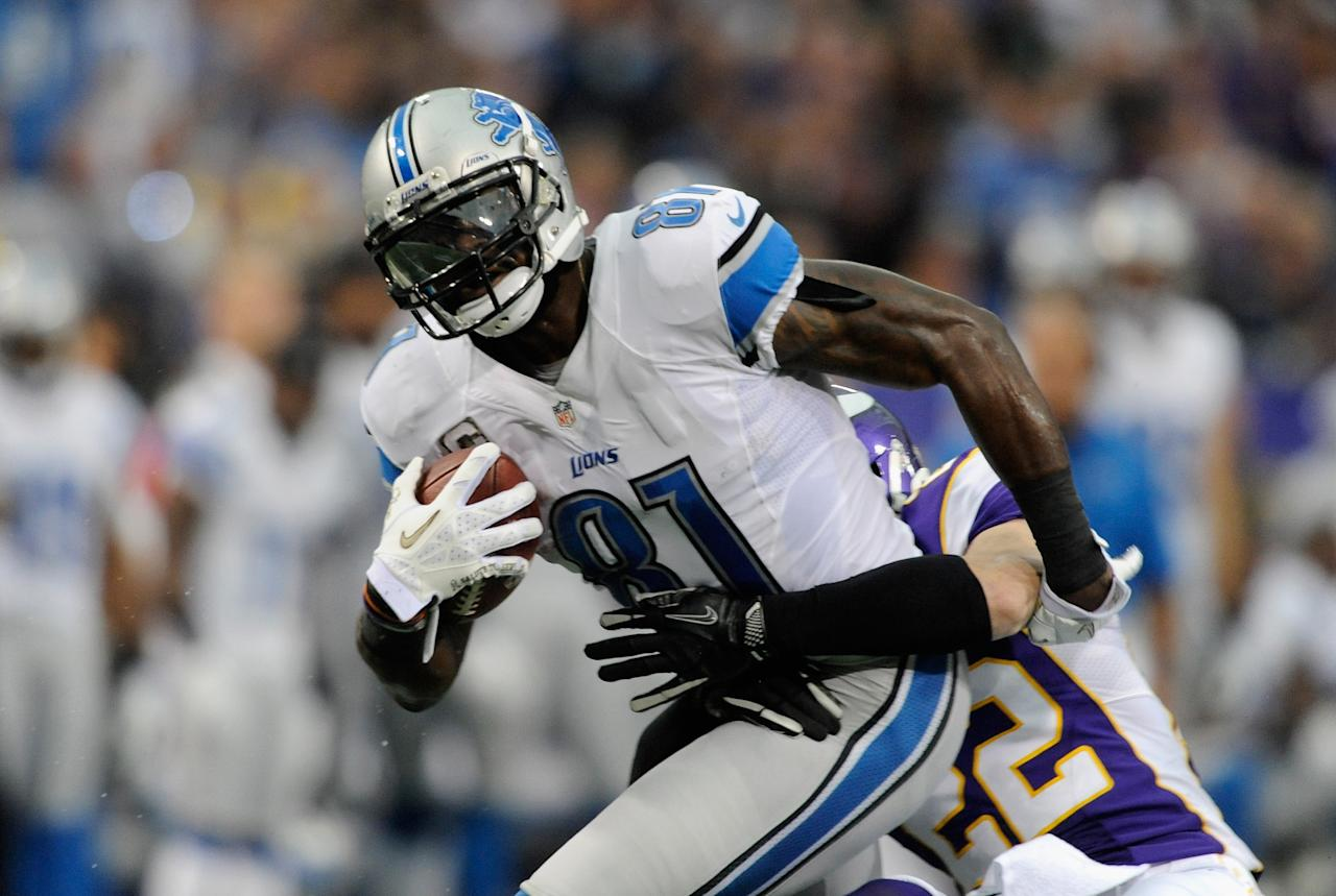 MINNEAPOLIS, MN - NOVEMBER 11: Harrison Smith #22 of the Minnesota Vikings tackles Calvin Johnson #81 of the Detroit Lions during the second quarter of the game on November 11, 2012 at Mall of America Field at the Hubert H. Humphrey Metrodome in Minneapolis, Minnesota. (Photo by Hannah Foslien/Getty Images)