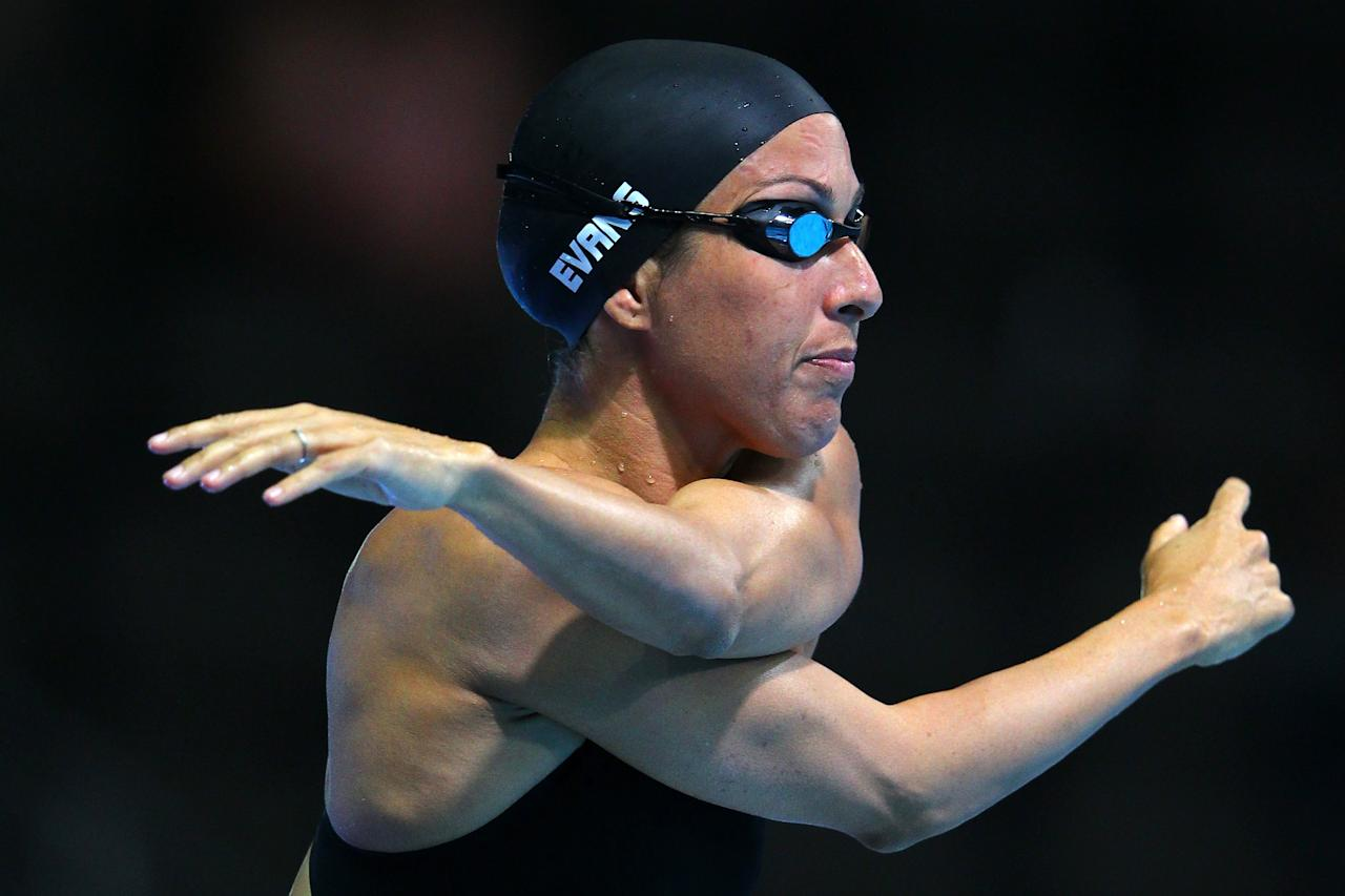 OMAHA, NE - JUNE 26:  Janet Evans stretches prior to swimming in preliminary heat 6 of the Women's 400 m Freestyle during Day Two of the 2012 U.S. Olympic Swimming Team Trials at CenturyLink Center on June 26, 2012 in Omaha, Nebraska.  (Photo by Al Bello/Getty Images)