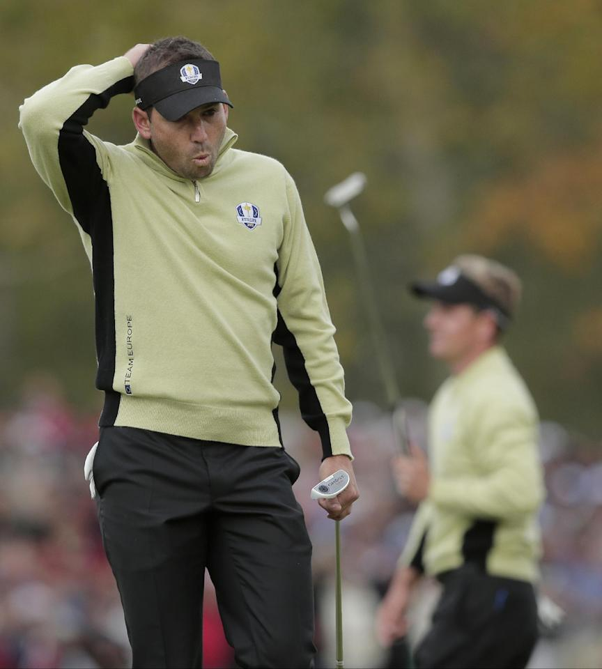 Europe's Sergio Garcia, left, reacts after teammate Luke Donald misses a putt on the fifth hole during a foresomes match at the Ryder Cup PGA golf tournament Friday, Sept. 28, 2012, at the Medinah Country Club in Medinah, Ill. (AP Photo/Charlie Riedel)