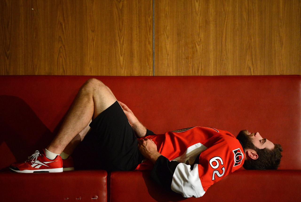 Ottawa Senators NHL hockey player Eric Gryba waits to pose for a TV portrait on the first day of training camp in Ottawa, Wednesday, Sept. 11, 2013. (AP Photo/The Canadian Press, Sean Kilpatrick
