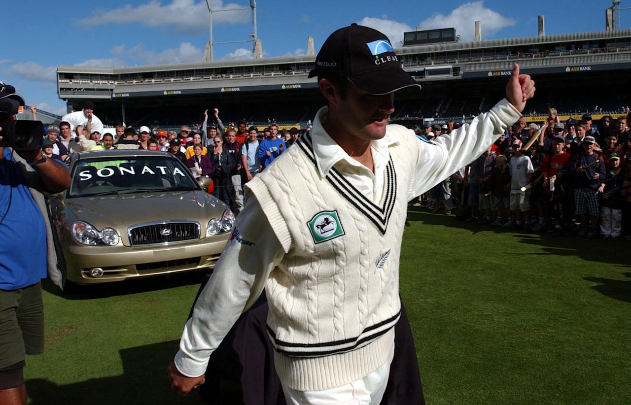 AUCKLAND, NEW ZEALAND - APRIL 03:  Man of the tour Nathan Astle walks away from his new car after the last day of the third Cricket test match between the New Zealand Black Caps and England played at Eden Park, Wednesday. New Zealand won the match by 78 runs leaving the series tied at England1, New Zealand 1 and a draw.  (Photo by Dean Purcell/Getty Images)
