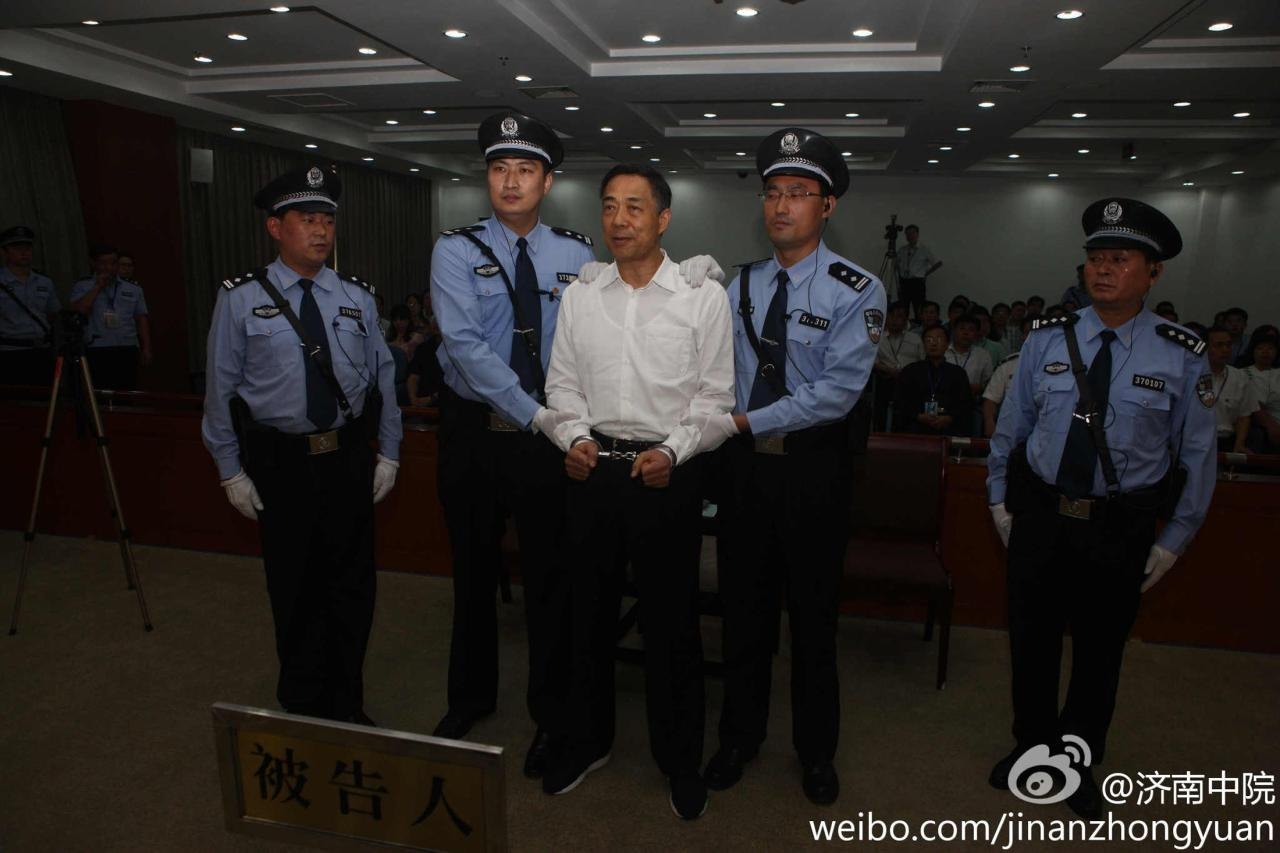Ousted Chinese politician Bo Xilai (C) is handcuffed after the announcement of his verdict inside the court in Jinan, Shandong province September 22, 2013, in this photo released by Jinan Intermediate People's Court. The court sentenced former Chongqing Municipality Communist Party Secretary Bo to life in prison on Sunday after finding him guilty of all the charges he faced of corruption, taking bribes and abuse of power. REUTERS/Jinan Intermediate People's Court/Handout via Reuters (CHINA - Tags: POLITICS CRIME LAW TPX IMAGES OF THE DAY)