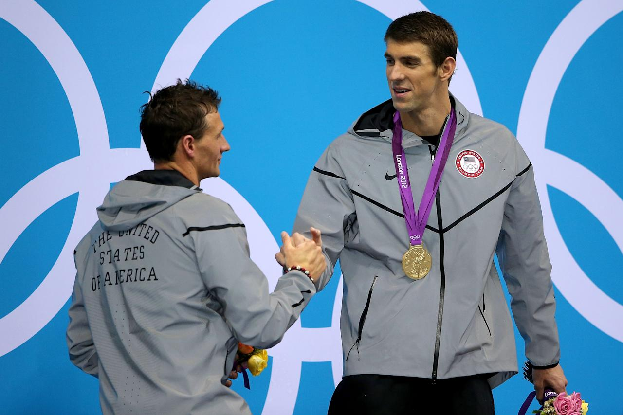 Gold medallist Michael Phelps (R) of the United States shakes hands with Silver medallist Ryan Lochte of the United States on the podium during the medal ceremony for the Men's 200m Individual Medley final on Day 6 nof the London 2012 Olympic Games at the Aquatics Centre on August 2, 2012 in London, England.  (Photo by Ezra Shaw/Getty Images)