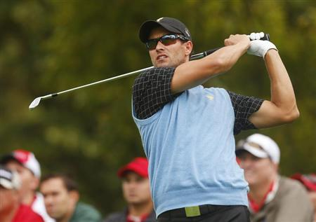 International team member Adam Scott of Australia hits of the 4th tee in his match against Bill Haas of the U.S. during the Singles matches for the 2013 Presidents Cup golf tournament at Muirfield Village Golf Club in Dublin