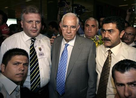 Luis Aragones is surrounded by supporters and officials upon his arrival at Ataturk Airport