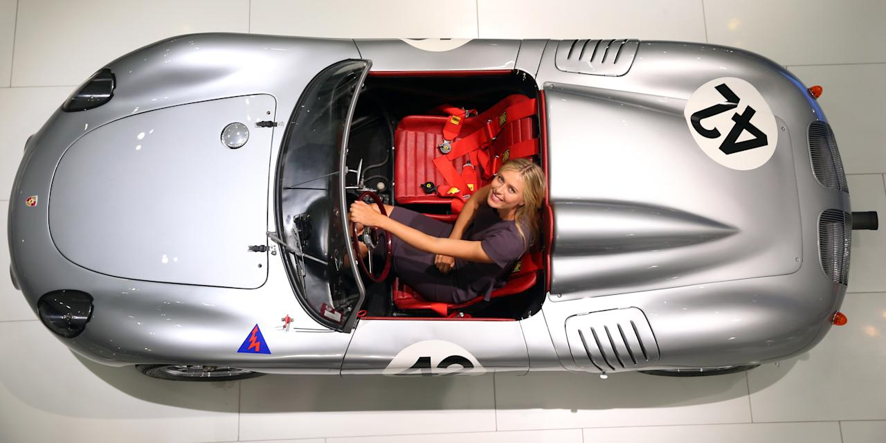 STUTTGART, GERMANY - APRIL 22:  Tennis player Maria Sharapova poses in a Porsche 718  RS 60 Spyder at the Porsche Museum on April 22, 2013 in Stuttgart, Germany.  (Photo by Alexander Hassenstein/Bongarts/Getty Images)