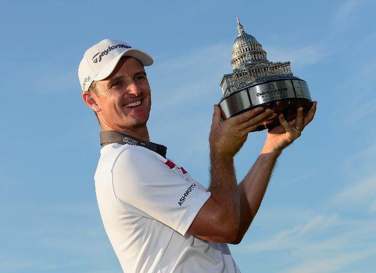 Justin Rose of England holds the trophy after winning the $6.5 million US PGA National on June 29, 2014 in Bethesda, Maryland