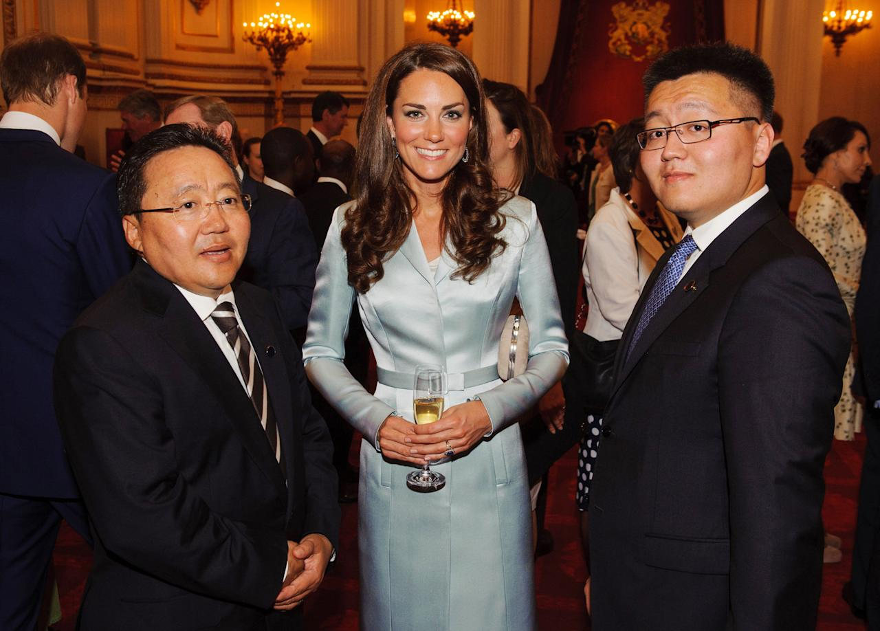 LONDON, ENGLAND - JULY 27:  Catherine, Duchess of Cambridge poses with President of Mongolia Elbegdorj Tsakhia (L) during a reception at Buckingham Palace a reception for Heads of State and Government attending the Olympics Opening Ceremony  on July 27, 2012 in London, England.  (Photo by Dominic Lipinski - WPA Pool/Getty Images)