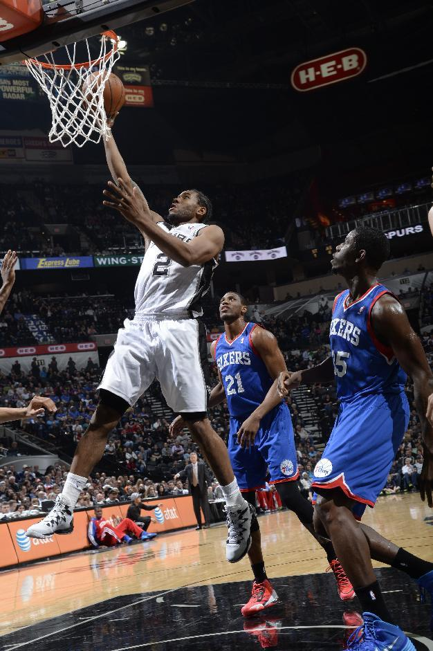 Spurs win 14th straight, 76ers' skid now at 25