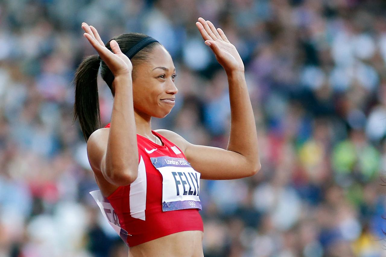 LONDON, ENGLAND - AUGUST 04: Allyson Felix of the United States waves after competing in the Women's 100m Semi Final on Day 8 of the London 2012 Olympic Games at Olympic Stadium on August 4, 2012 in London, England.  (Photo by Jamie Squire/Getty Images)