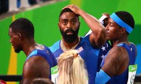 2016 Rio Olympics - Athletics - Final - Men's 4 x 100m Relay Final - Olympic Stadium - Rio de Janeiro, Brazil - 19/08/2016. Mike Rodgers (USA) Justin Gatlin (USA) and Tyson Gay (USA) of USA react as they realise  they have been disqualified      REUTERS/David Gray