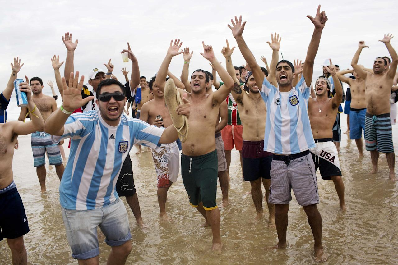 Argentina soccer fans chant slogans, holding up seven fingers to refer to Brazil's 7-1 loss to Germany at the World Cup semifinals on Copacabana beach in Rio de Janeiro, Brazil, Friday, July 11, 2014. Argentina will face Germany at the final World Cup match on Sunday. (AP Photo/Rodrigo Abd)