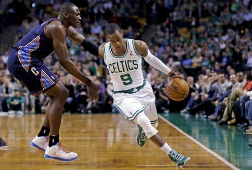 Boston Celtics point guard Rajon Rondo (9) drives past Charlotte Bobcats forward Bismack Biyombo during the first quarter of an NBA basketball game in Boston, Monday, Jan. 14, 2013. (AP Photo/Charles Krupa)