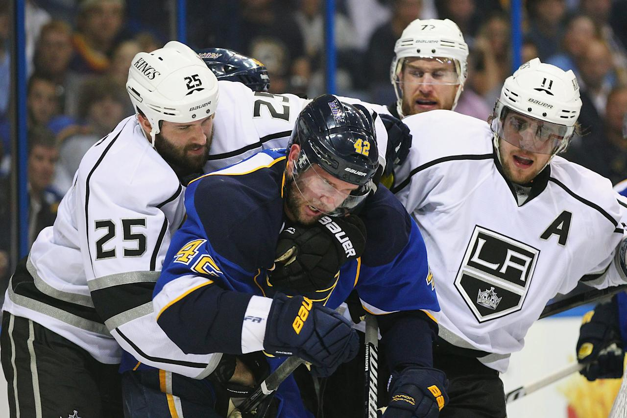 ST. LOUIS, MO - APRIL 30: Dustin Penner #25 and Anze Kopitar #11 both of the Los Angeles Kings mix it up with David Backes #42 of the St. Louis Blues  in Game Two of the Western Conference Semifinals during the 2012 NHL Stanley Cup Playoffs at the Scottrade Center  on April 30, 2012 in St. Louis, Missouri.  (Photo by Dilip Vishwanat/Getty Images)