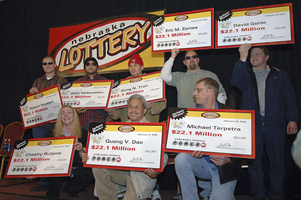 <b>$365 million</b><br><br>The eight winners of the $365 million Nebraska Powerball lottery pose with their individual checks in Lincoln, Neb., Wednesday, Feb. 22, 2006. Eight workers at a Nebraska meat processing plant claimed the record $365 million Powerball jackpot Wednesday, giving each about $15.5 million after taxes. The seven men and one woman all work at a ConAgra ham processing plant near the U-Stop convenience store where they bought the winning ticket last week for Saturday's lottery. Clockwise from top left: Robert Stewart, Alain Maboussou, Dung Tran, Eric Zornes, David Gehle, Michael Terpstra, Quang Dao and Chasity Rutjens.