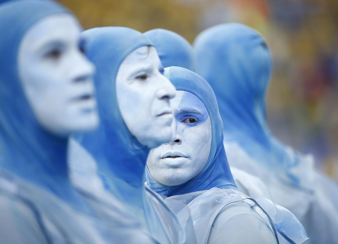 Performers dance in costumes during the 2014 World Cup opening ceremony at the Corinthians arena in Sao Paulo June 12, 2014. REUTERS/Murad Sezer (BRAZIL - Tags: SOCCER SPORT WORLD CUP SOCIETY)
