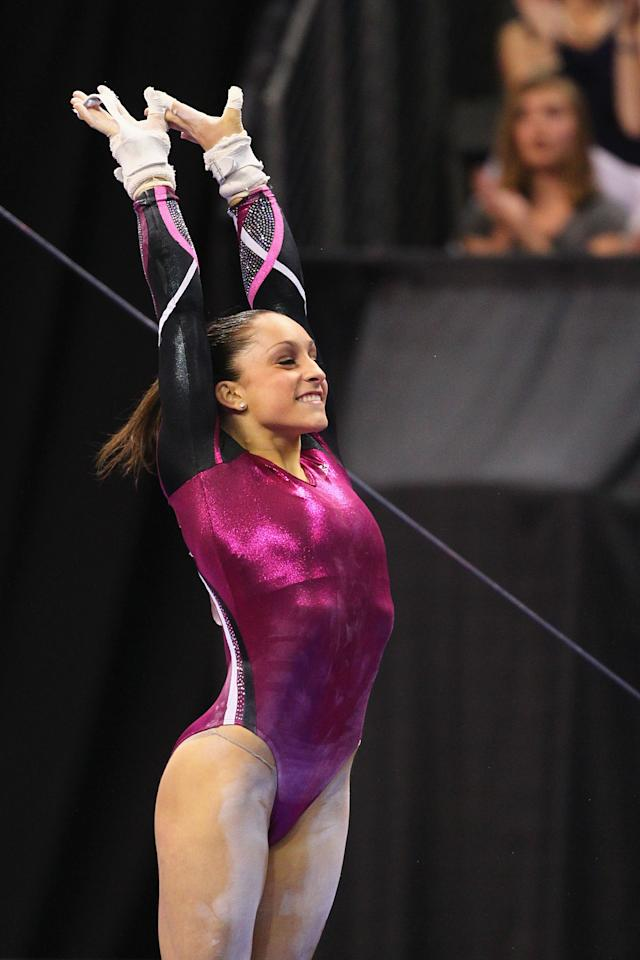 ST. LOUIS, MO - JUNE 10: Jordyn Wieber sticks her landing on the uneven bars during the Senior Women's competition on day four of the Visa Championships at Chaifetz Arena on June 10, 2012 in St. Louis, Missouri.  (Photo by Dilip Vishwanat/Getty Images)
