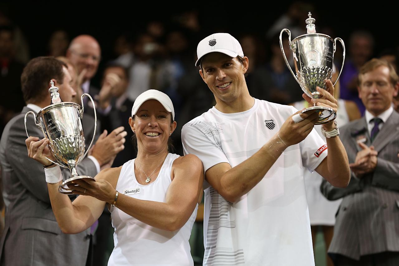 LONDON, ENGLAND - JULY 08:  Mike Bryan (R) and Lisa Raymond of the USA hold up the winners trophy after winning their Mixed Doubles final against Elena Vesnina of Russia and Leander Paes of India on day thirteen of the Wimbledon Lawn Tennis Championships at the All England Lawn Tennis and Croquet Club on July 8, 2012 in London, England.  (Photo by Julian Finney/Getty Images)