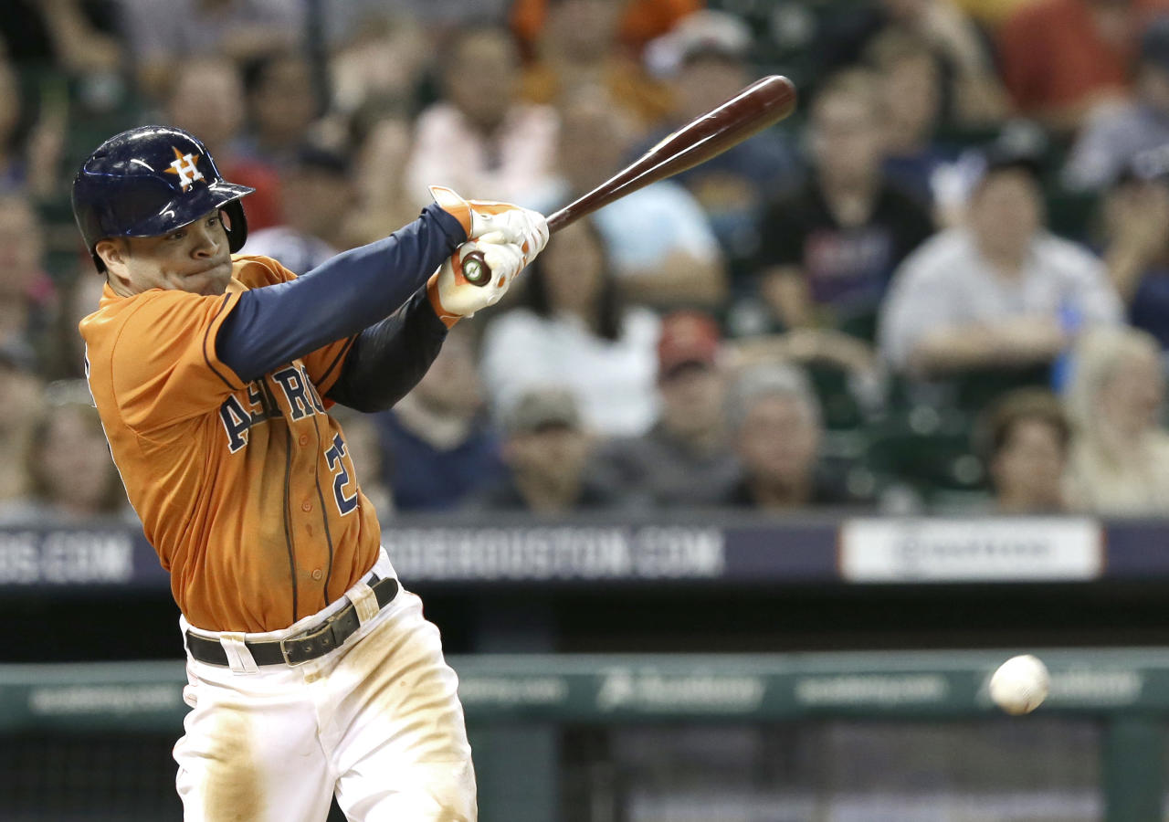 Houston Astros' Jose Altuve hits a single against the Detroit Tigers in the seventh inning of a baseball game Friday, June 27, 2014, in Houston. (AP Photo/Pat Sullivan)