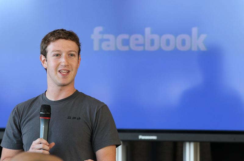 Zuckerberg urges Harvard grads to build a world of 'purpose'