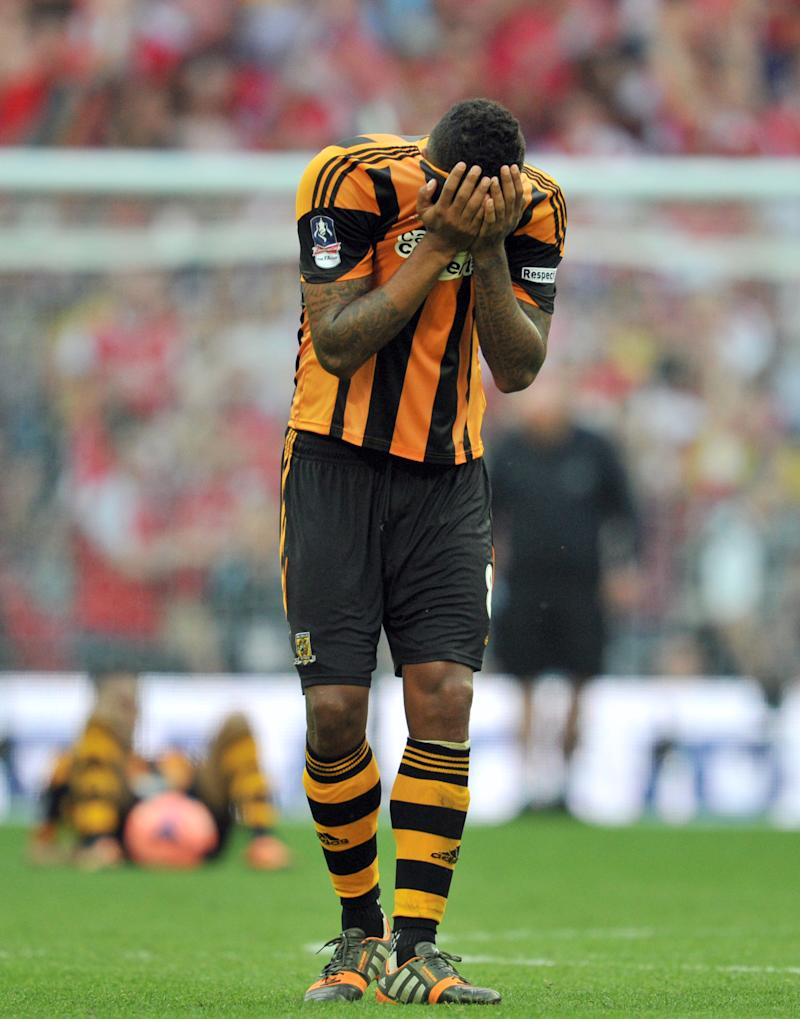 Hull City's English midfielder Tom Huddlestone reacts after losing the English FA Cup final match against Arsenal at Wembly Stadium in London on May 17, 2014