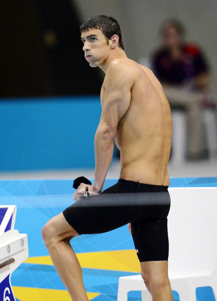 United States' Michael Phelps reacts after his team won the silver medal in the men's 4x100-meter freestyle relay final at the Aquatics Centre in the Olympic Park during the 2012 Summer Olympics in London, Sunday, July 29, 2012. (AP Photo/The Canadian Press, Sean Kilpatrick)