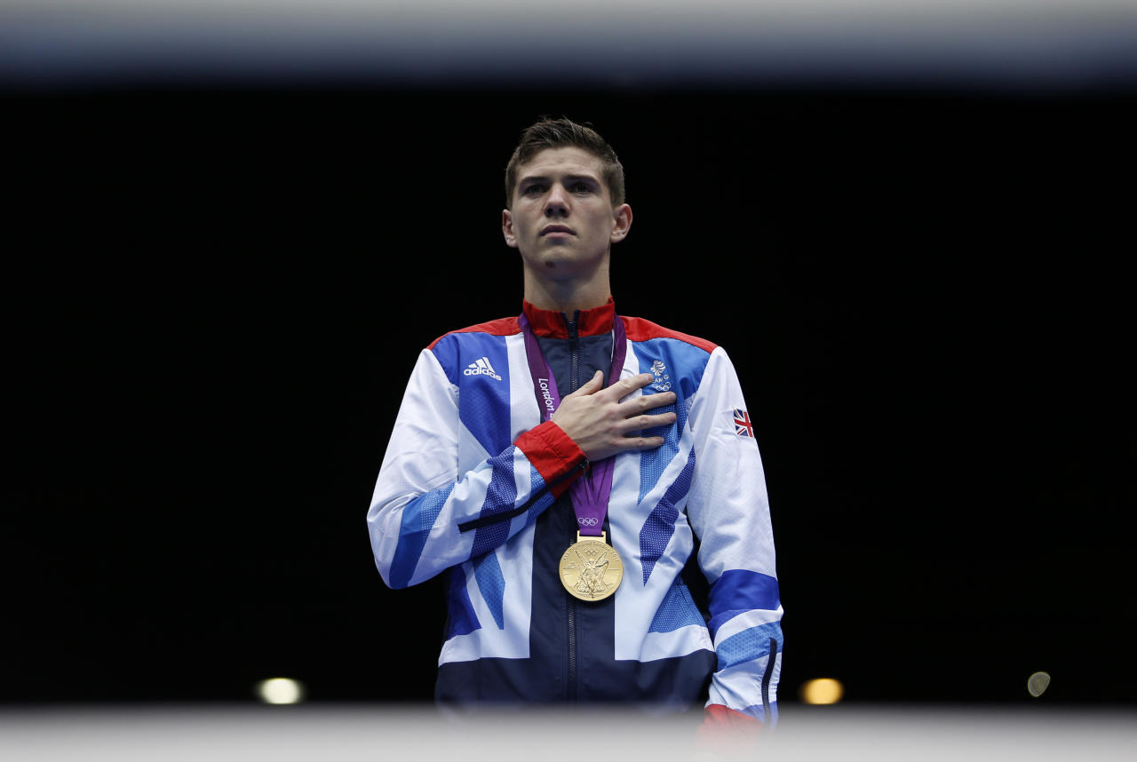 Luke Campbell of Britain stands with his gold medal for the playing of the national anthem during the presentation ceremony for the Men's Bantam (56kg) boxing competition at the London Olympics August 11, 2012.         REUTERS/Damir Sagolj (BRITAIN  - Tags: SPORT BOXING OLYMPICS)