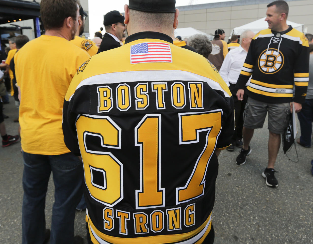 "A fan wears a Boston Bruins jersey bearing the Boston area code and ""Boston Strong,"" remembering the city's solidarity after the Boston Marathon bombing in April, before Game 4 of the NHL hockey Stanley Cup Finals between the Bruins and the Chicago Blackhawks, Wednesday, June 19, 2013, in Boston. (AP Photo/Charles Krupa)"