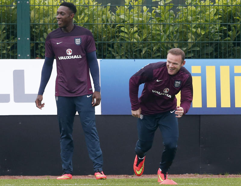 England strikers Danny Welbeck (L) and Wayne Rooney share a joke during a training session at London Colney, north of London, on September 1, 2014