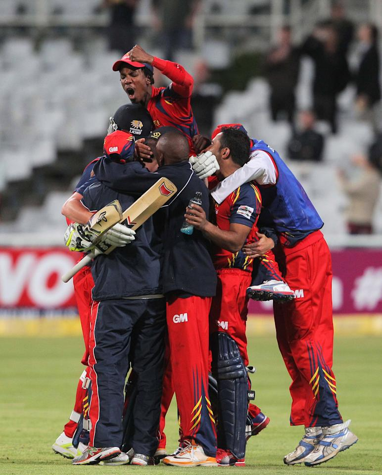 CAPE TOWN, SOUTH AFRCA - OCTOBER 16:  Highveld Lions players celebrate their win during the Karbonn Smart CLT20 match between Chennai Super Kings (IPL) and Highveld Lions (South Africa) at Sahara Park Newlands on October 16, 2012 in Cape Town, South Africa.  (Photo by Carl Fourie/Gallo Images/Getty Images)