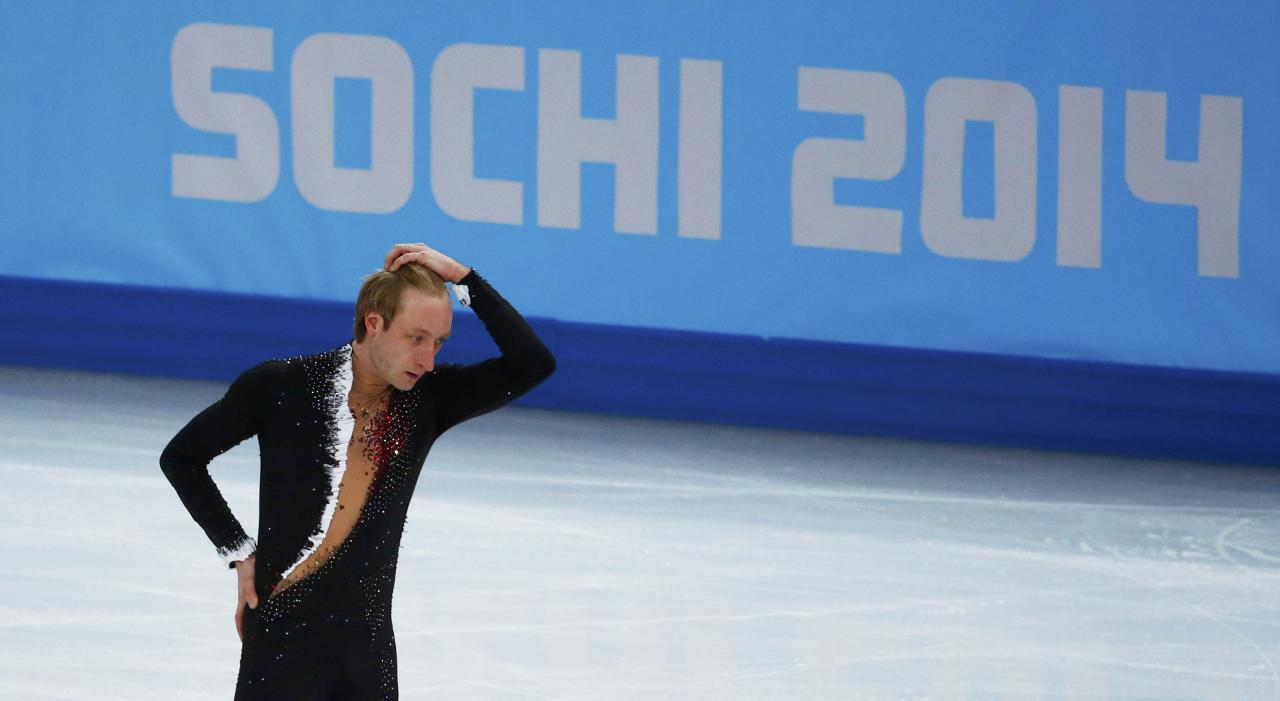 Russia's Evgeny Plyushchenko withdraws during the Figure Skating Men's Short Program at the Sochi 2014 Winter Olympics, February 13, 2014. REUTERS/David Gray (RUSSIA - Tags: OLYMPICS SPORT FIGURE SKATING)