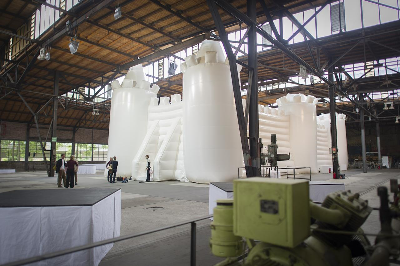 "BERLIN, GERMANY - JUNE 27: General overview from the ""White Bouncy Castle"" a installation from artist William Forsythe on June 27, 2013 in Berlin, Germany. The work is a giant, inflatable white castle that Forsythe says encourages people to dance the moment they step into it. ""White Bouncy Castle"" will be open to visitors at Lokhalle Schoeneberg until July 14 and is part of the ""Foreign Affairs"" series of Berliner Festspiele. (Photo by Timur Emek/Getty Images)"