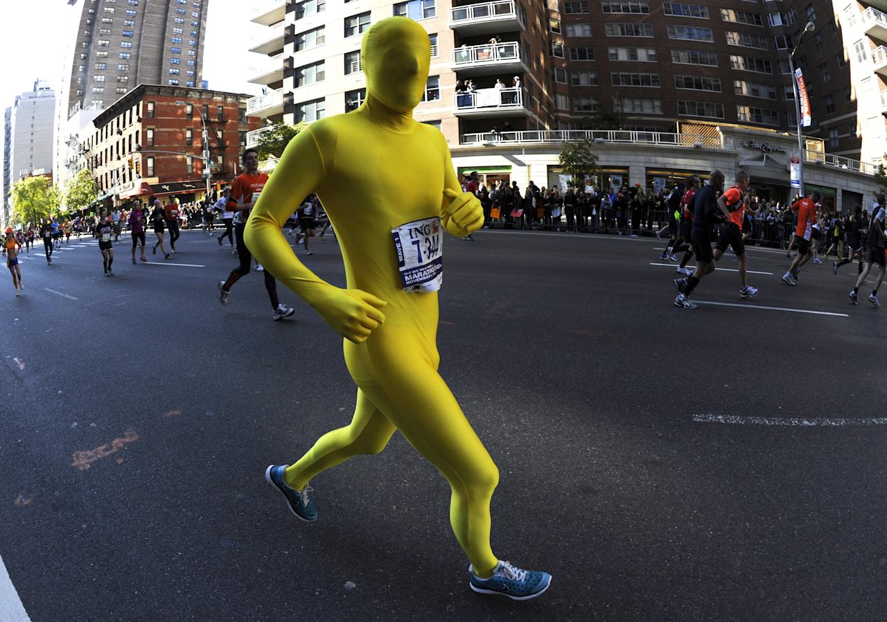 Runners as they make their way up 1st Avenue in Manhattan during the 2011 ING New York City Marathon in New York November 6, 2011.  The 26.2 mile marathon course is through the five bouroughs of New York  City and is one of the largest in the world. AFP PHOTO  TIMOTHY A. CLARY (Photo credit should read TIMOTHY A. CLARY/AFP/Getty Images)