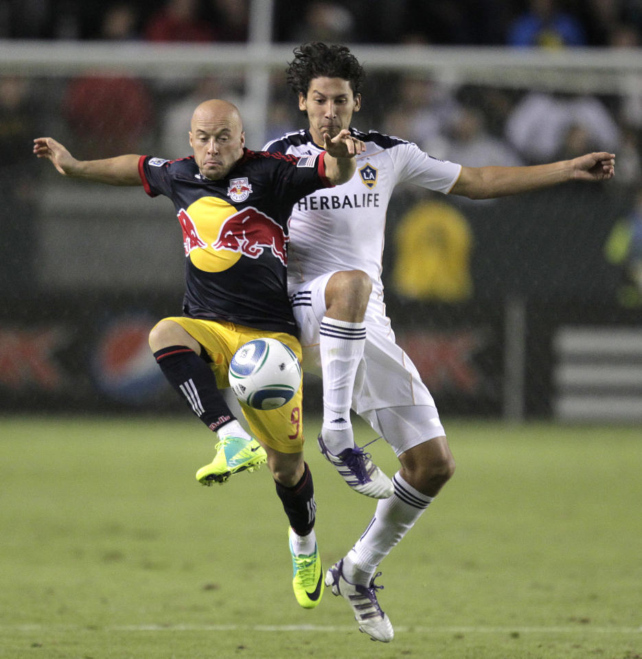 New York Red Bulls forward Luke Rodgers, left, and Los Angeles Galaxy defender Omar Gonzalez fight for the ball during the second half of the second game of an MLS soccer Western Conference semifinal at Home Depot Center in Carson, Calif., Thursday, Nov. 3, 2011. The Galaxy won 2-1. (AP Photo/Jae Hong)