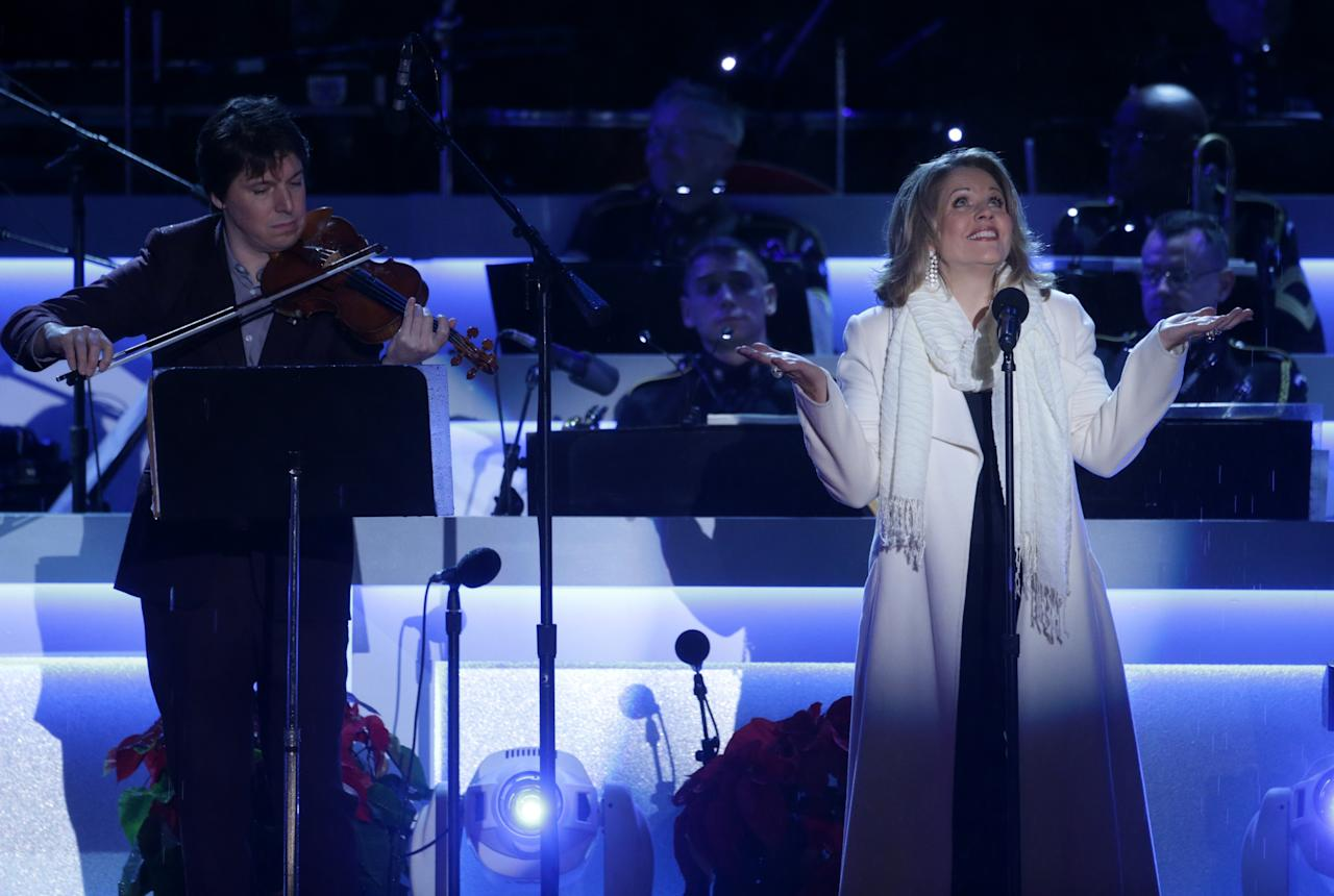 WASHINGTON, DC - DECEMBER 06: Singer Renée Fleming (R) and violinist Joshua Bell (L) perform during the National Christmas Tree lighting ceremony at the Ellipse December 6, 2013 in Washington, DC. U.S. President Barack Obama and his family were joined by entertainers at the annual event to celebrate the holiday season. (Photo by Alex Wong/Getty Images)