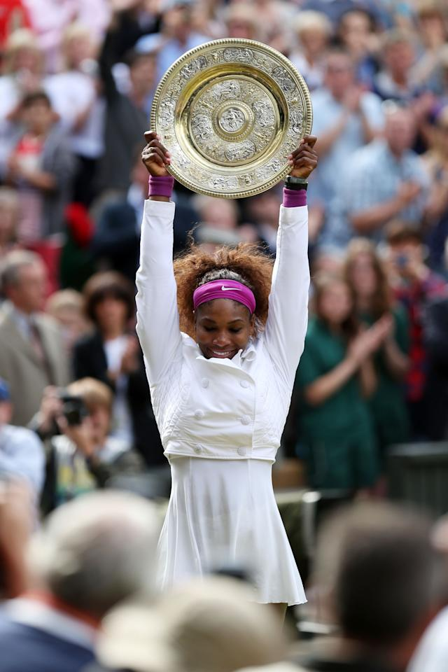LONDON, ENGLAND - JULY 07:  Serena Williams of the USA lifts the winners trophy and celebrates after her Ladies? Singles final match against Agnieszka Radwanska of Poland on day twelve of the Wimbledon Lawn Tennis Championships at the All England Lawn Tennis and Croquet Club on July 7, 2012 in London, England.  (Photo by Clive Rose/Getty Images)